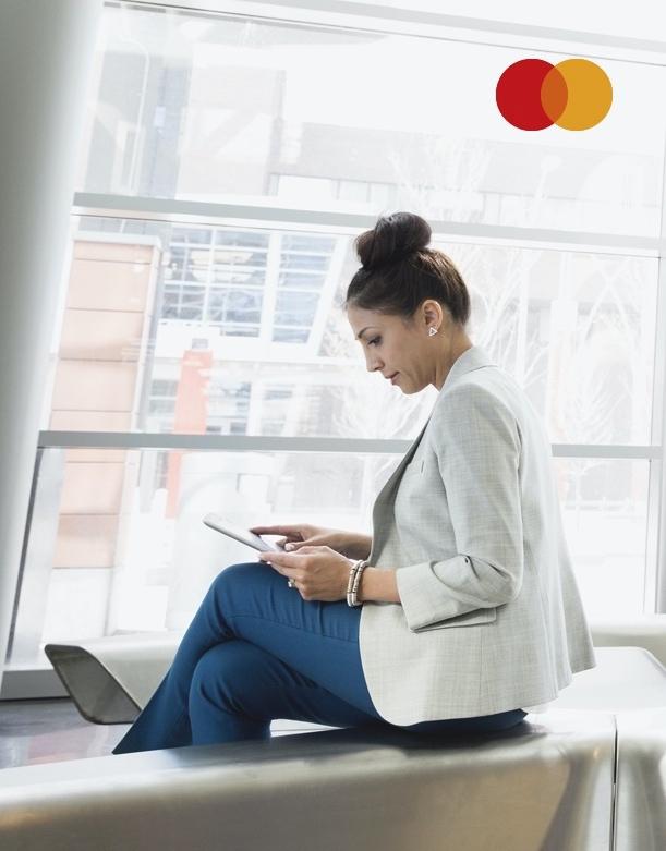 Businesswoman using digital tablet in modern lobby